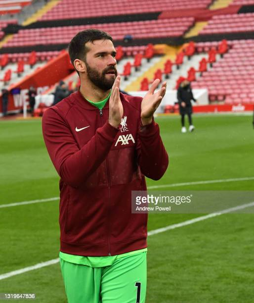 Alisson Becker of Liverpool at the end of the Premier League match between Liverpool and Crystal Palace at Anfield on May 23, 2021 in Liverpool,...