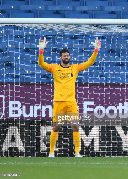 Alisson Becker of Liverpool before the Premier League match between Burnley and Liverpool at Turf Moor on May 19, 2021 in Burnley, England.