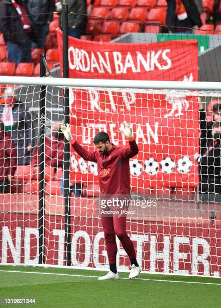 Alisson Becker of Liverpool before the Premier League match between Liverpool and Crystal Palace at Anfield on May 23, 2021 in Liverpool, England.