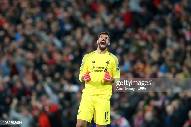Alisson Becker of Liverpool celebrates after the Group C match of the UEFA Champions League between Liverpool and Paris SaintGermain at Anfield on...