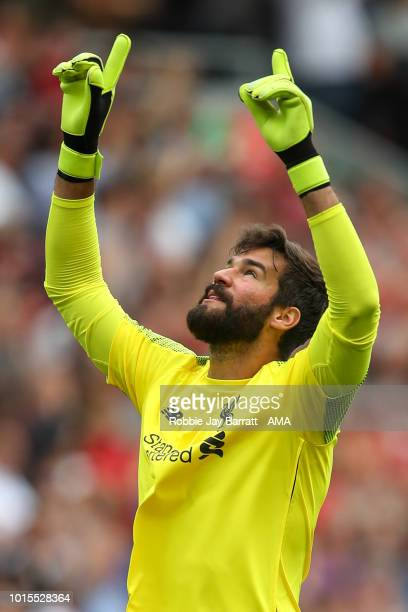 Alisson Becker of Liverpool celebrates after the second goal during the Premier League match between Liverpool FC and West Ham United at Anfield on...