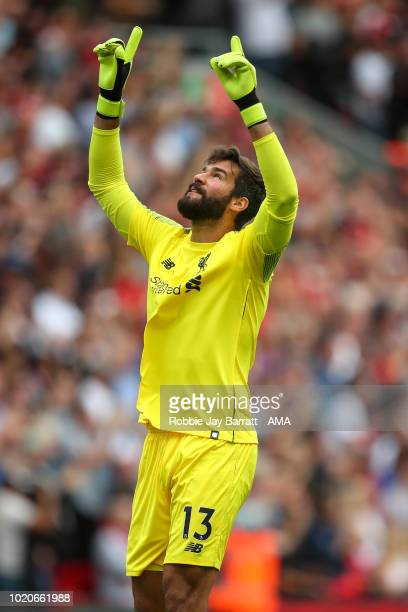 Alisson Becker of Liverpool celebrates during the Premier League match between Liverpool FC and West Ham United at Anfield on August 12 2018 in...
