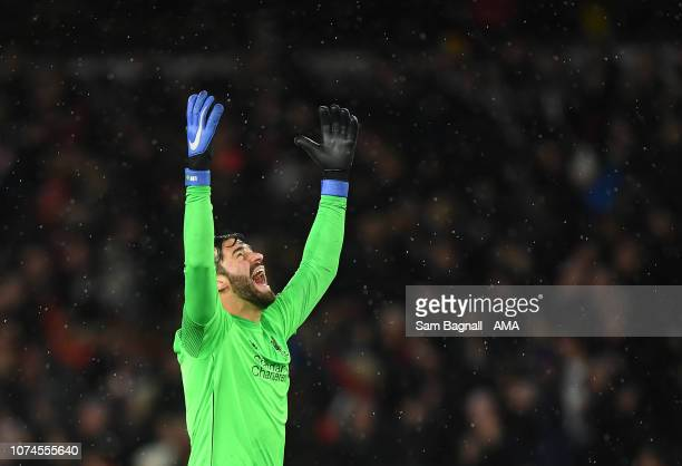 Alisson Becker of Liverpool celebrates during the Premier League match between Wolverhampton Wanderers and Liverpool FC at Molineux on December 21...