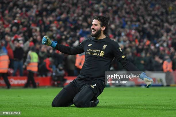 Alisson Becker of Liverpool celebrates the 2nd goal during the Premier League match between Liverpool FC and Manchester United at Anfield on January...