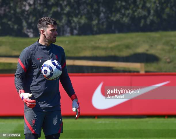 Alisson Becker of Liverpool during a training session at AXA Training Centre on April 22, 2021 in Kirkby, England.