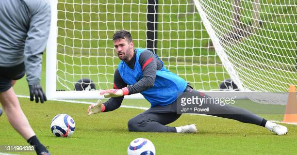 Alisson Becker of Liverpool during a training session at AXA Training Centre on April 28, 2021 in Kirkby, England.