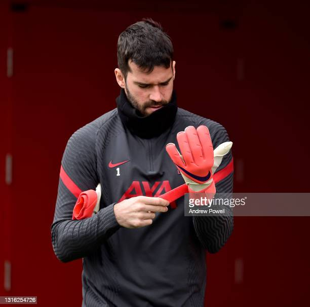 Alisson Becker of Liverpool during a training session at AXA Training Centre on May 04, 2021 in Kirkby, England.