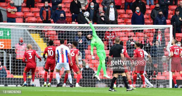 Alisson Becker of Liverpool during the Premier League match between Liverpool and Crystal Palace at Anfield on May 23, 2021 in Liverpool, England.