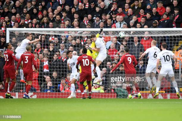 Alisson Becker of Liverpool fails to stop a ball from Ashley Westwood of Burnley as scores his sides first goal from a corner during the Premier...
