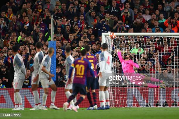 Alisson Becker of Liverpool fails to stop Lionel Messi of FC Barcelona from scoring a goal to make it 3-0 and his 600th goal for Barcelona during the...