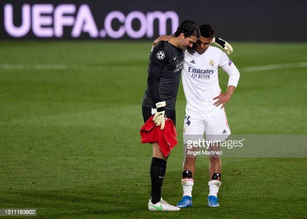 Alisson Becker of Liverpool FC and Casemiro of Real Madrid interact at the end of the UEFA Champions League Quarter Final match between Real Madrid...