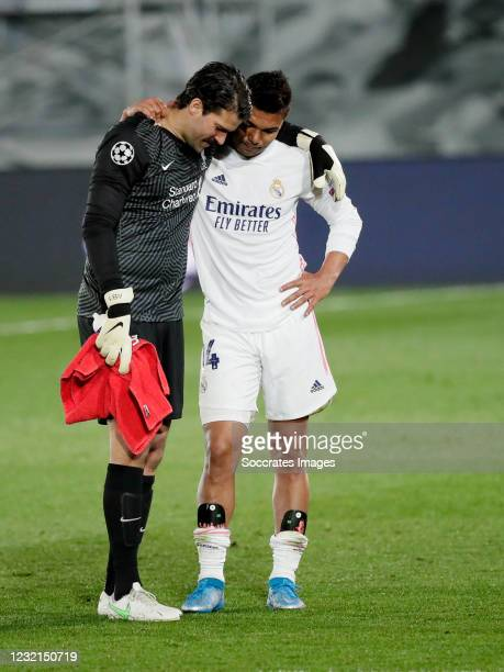 Alisson Becker of Liverpool FC, Casemiro of Real Madrid during the UEFA Champions League match between Real Madrid v Liverpool at the Estadio Alfredo...