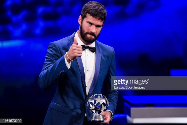 Alisson Becker of Liverpool FC poses for photo during the Kick-Off 2019/2020 - UEFA Champions League Draw on August 29, 2019 in Monaco, Monaco.