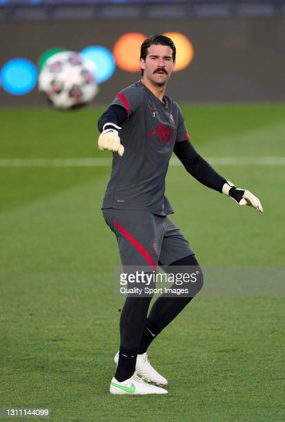 Alisson Becker of Liverpool FC warms up prior to the UEFA Champions League Quarter Final match between Real Madrid and Liverpool FC at Estadio...