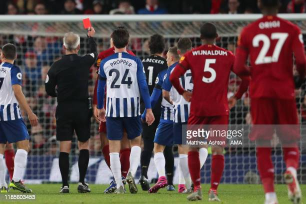 Alisson Becker of Liverpool gets a red card during the Premier League match between Liverpool FC and Brighton & Hove Albion at Anfield on November...