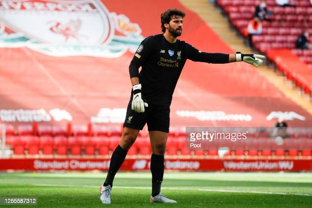 Alisson Becker of Liverpool gives his team instructions during the Premier League match between Liverpool FC and Burnley FC at Anfield on July 11...