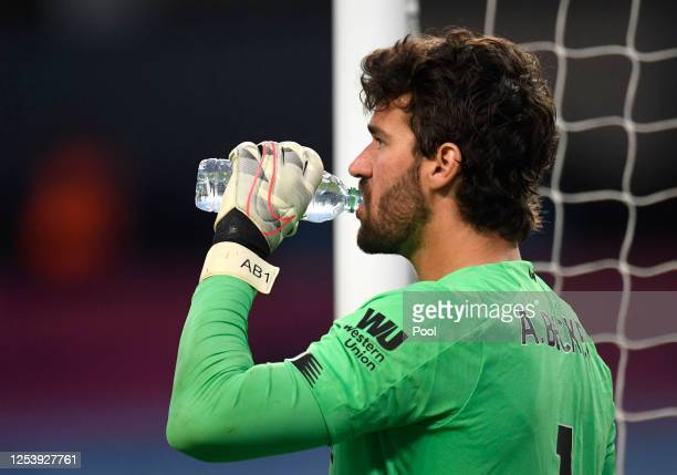 Alisson Becker of Liverpool has a drink during the Premier League match between Manchester City and Liverpool FC at Etihad Stadium on July 02 2020 in...