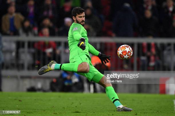 Alisson Becker of Liverpool in action during the UEFA Champions League Round of 16 Second Leg match between FC Bayern Muenchen and Liverpool at...
