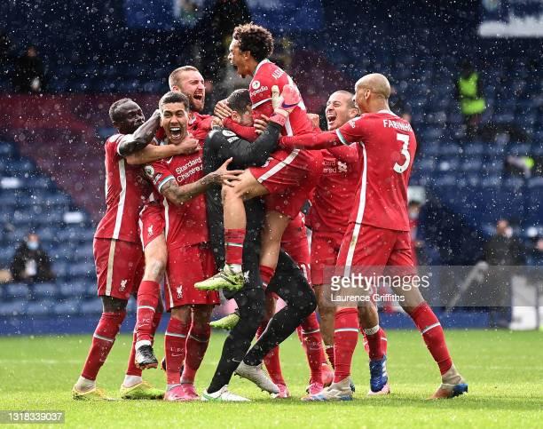 Alisson Becker of Liverpool is congratulated by Sadio Mane, Roberto Firmino, Thiago Alcantara, Trent Alexander-Arnold and Fabinho after scoring the...
