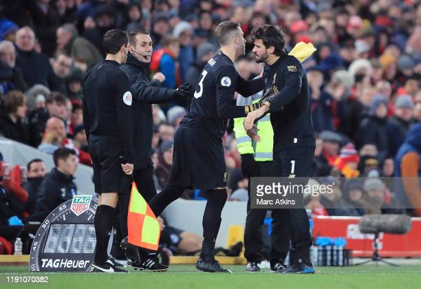 Alisson Becker of Liverpool is replaced by Adrian after receiving red card during the Premier League match between Liverpool FC and Brighton Hove...