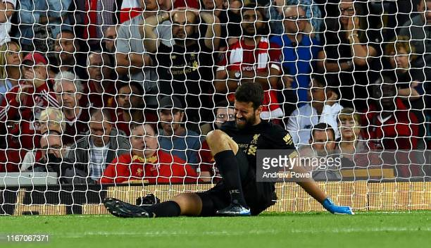 Alisson Becker of Liverpool Leaves the pitch after a Injuryb during the Premier League match between Liverpool FC and Norwich City at Anfield on...