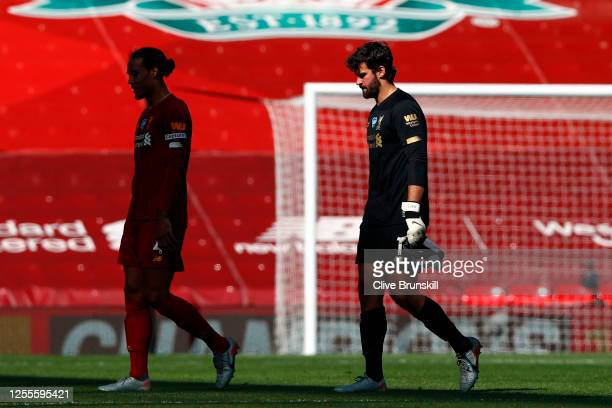 Alisson Becker of Liverpool leaves the pitch following the Premier League match between Liverpool FC and Burnley FC at Anfield on July 11 2020 in...