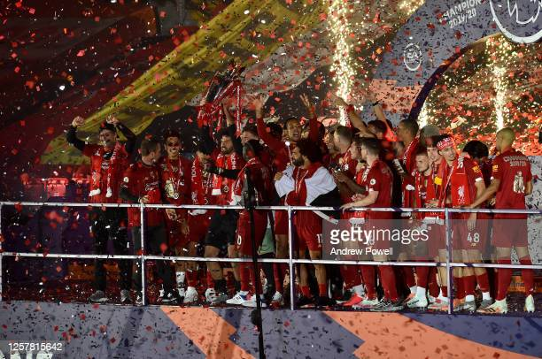 Alisson Becker of Liverpool lifting the Premier League trophy with the rest of the Liverpool team at the end of the Premier League match between...