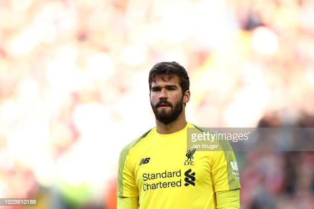 Alisson Becker of Liverpool looks on during the Premier League match between Liverpool FC and Brighton Hove Albion at Anfield on August 25 2018 in...