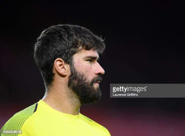 Alisson Becker of Liverpool looks on during the Premier League match between Liverpool FC and Manchester City at Anfield on October 07 2018 in...