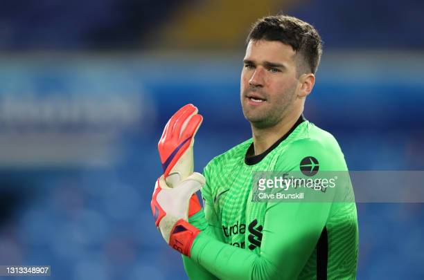 Alisson Becker of Liverpool looks on during the Premier League match between Leeds United and Liverpool at Elland Road on April 19, 2021 in Leeds,...
