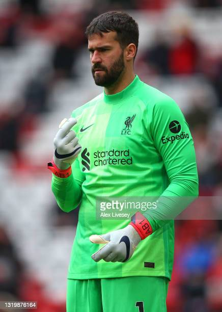 Alisson Becker of Liverpool looks on during the Premier League match between Liverpool and Crystal Palace at Anfield on May 23, 2021 in Liverpool,...