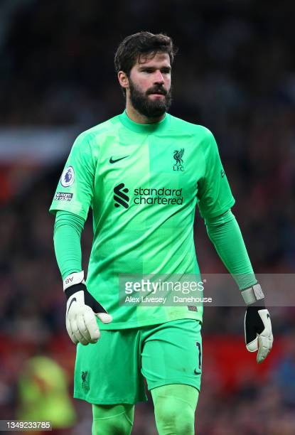 Alisson Becker of Liverpool looks on during the Premier League match between Manchester United and Liverpool at Old Trafford on October 24, 2021 in...