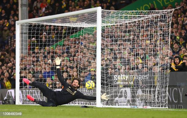 Alisson Becker of Liverpool looks to save a shot during the Premier League match between Norwich City and Liverpool FC at Carrow Road on February 15...