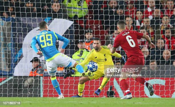 Alisson Becker of Liverpool makes a save from Arkadiusz Milik of SSC Napoli during the UEFA Champions League Group C match between Liverpool and SSC...
