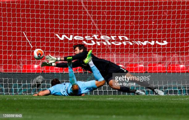 Alisson Becker of Liverpool makes a save from Jay Rodriguez of Burnley during the Premier League match between Liverpool FC and Burnley FC at Anfield...
