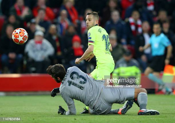 Alisson Becker of Liverpool makes a save from Jordi Alba of Barcelona during the UEFA Champions League Semi Final second leg match between Liverpool...