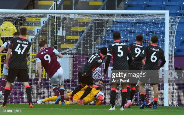 Alisson Becker of Liverpool makes save from Burnley's Chris Wood during the Premier League match between Burnley and Liverpool at Turf Moor on May...