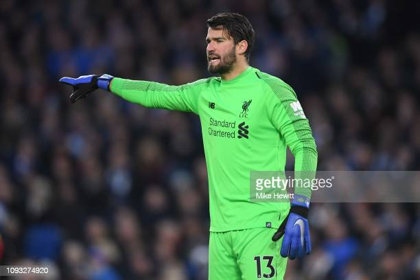 Alisson Becker of Liverpool points during the Premier League match between Brighton Hove Albion and Liverpool FC at American Express Community...