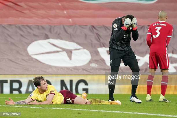 Alisson Becker of Liverpool reacts after fouling Ashley Barnes of Burnley leading to a penalty being awarded during the Premier League match between...