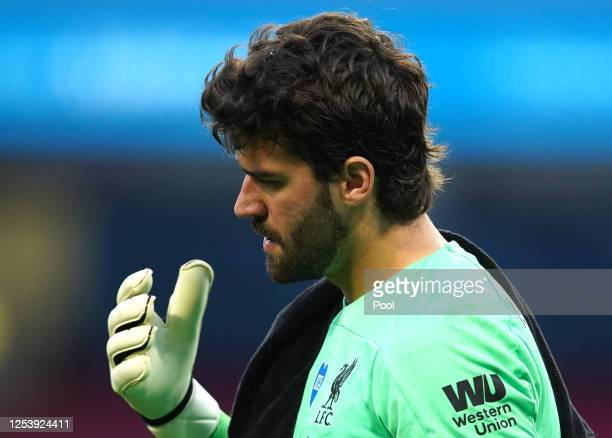 Alisson Becker of Liverpool reacts during the Premier League match between Manchester City and Liverpool FC at Etihad Stadium on July 02 2020 in...