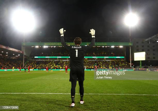 Alisson Becker of Liverpool reacts prior to the Premier League match between Norwich City and Liverpool FC at Carrow Road on February 15 2020 in...