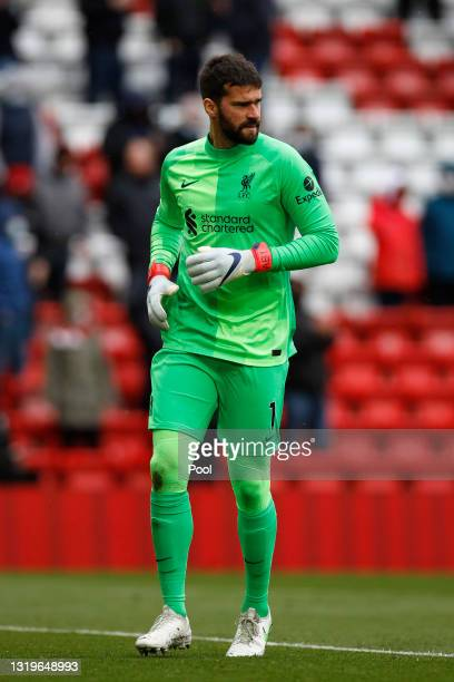 Alisson Becker of Liverpool runs off the ball during the Premier League match between Liverpool and Crystal Palace at Anfield on May 23, 2021 in...