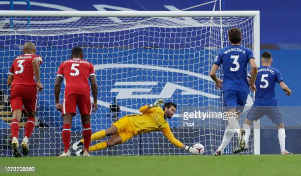 Alisson Becker of Liverpool saves a penalty from Jorginho of Chelsea during the Premier League match between Chelsea and Liverpool at Stamford Bridge...