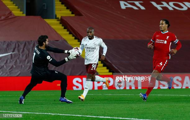Alisson Becker of Liverpool saves a shot from Alexandre Lacazette of Arsenal during the Premier League match between Liverpool and Arsenal at Anfield...