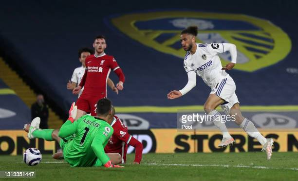 Alisson Becker of Liverpool saves a shot from Tyler Roberts of Leeds United during the Premier League match between Leeds United and Liverpool at...