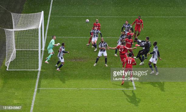 Alisson Becker of Liverpool scores the winning goal during the Premier League match between West Bromwich Albion and Liverpool at The Hawthorns on...