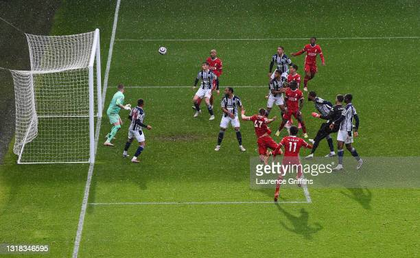 Alisson Becker of Liverpool scores the winning goal past Sam Johnstone of West Bromwich Albion during the Premier League match between West Bromwich...