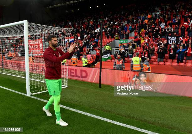Alisson Becker of Liverpool showing his appreciation to the fans at the end of the Premier League match between Liverpool and Crystal Palace at...