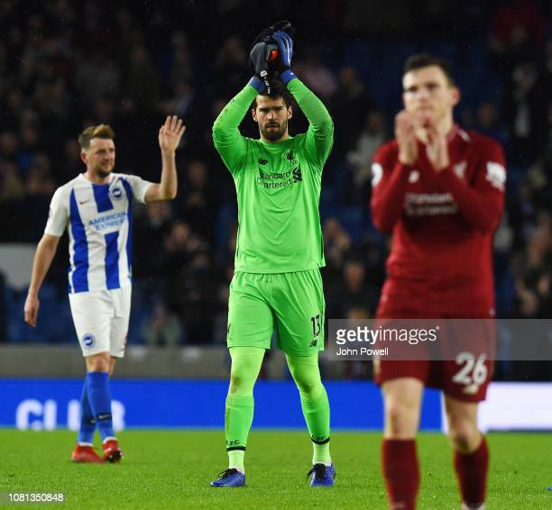 Alisson Becker of Liverpool shows his appreciation to the fans at the end of the Premier League match between Brighton Hove Albion and Liverpool FC...