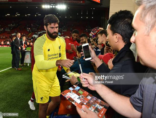 Alisson Becker of Liverpool signing autographs and taking selfies at the end of the PreSeason friendly match between Liverpool and Torino at Anfield...